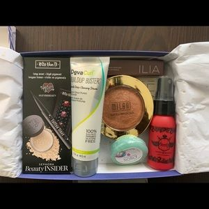 Box of sample and full size makeup products